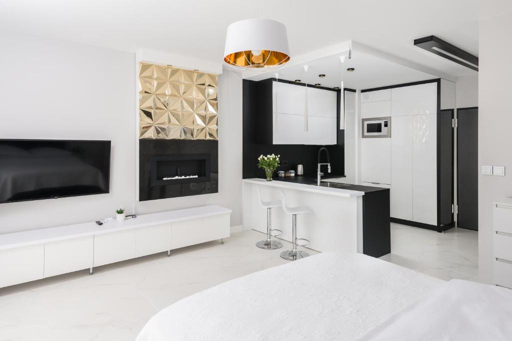 A television and/or entertainment centre at Dream4You Apartments
