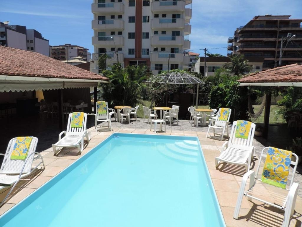 The swimming pool at or near Espaço Diferente Suítes