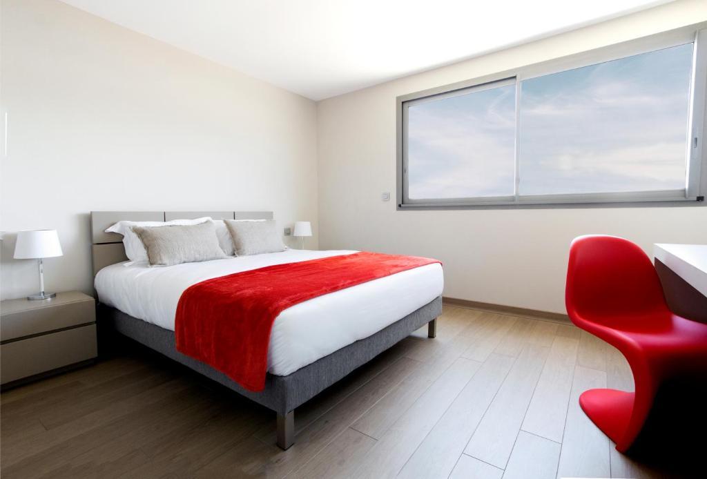 Кровать или кровати в номере Costa Nera