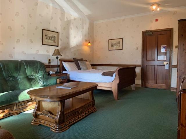 A bed or beds in a room at St Mary's Hotel Golf & Country Club