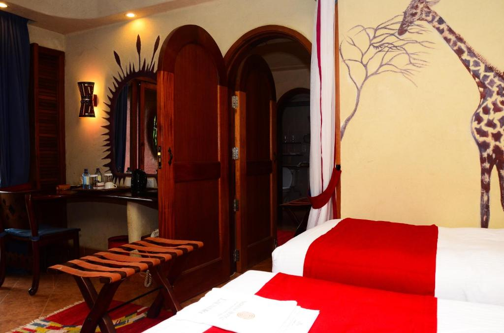 A bed or beds in a room at Amboseli Serena Safari Lodge