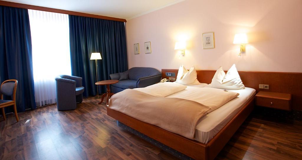 Ein Bett oder Betten in einem Zimmer der Unterkunft Hotel Carmen