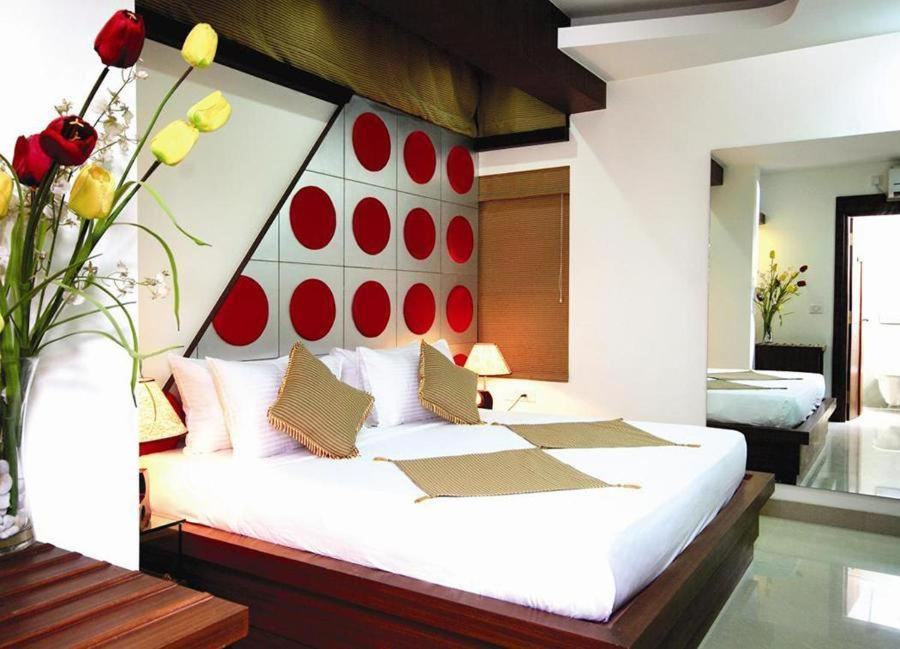A bed or beds in a room at Krishinton Suites