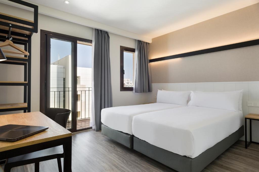 A bed or beds in a room at Acta BCN 40