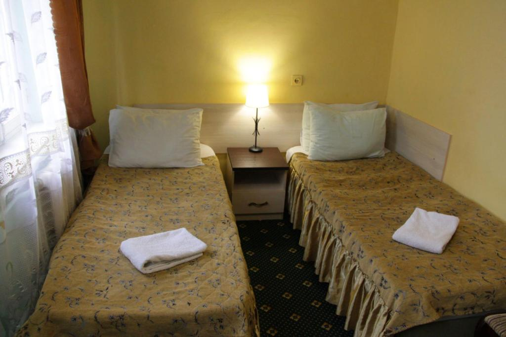 A bed or beds in a room at Hostel Tsentral