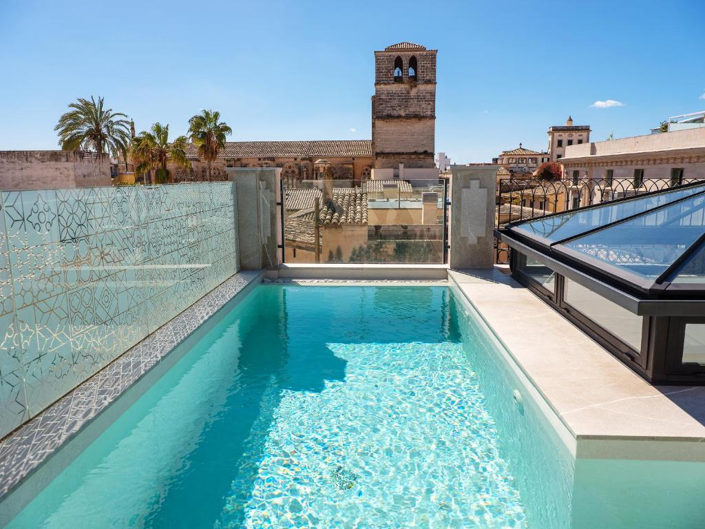 The swimming pool at or near Hotel Gloria de Sant Jaume