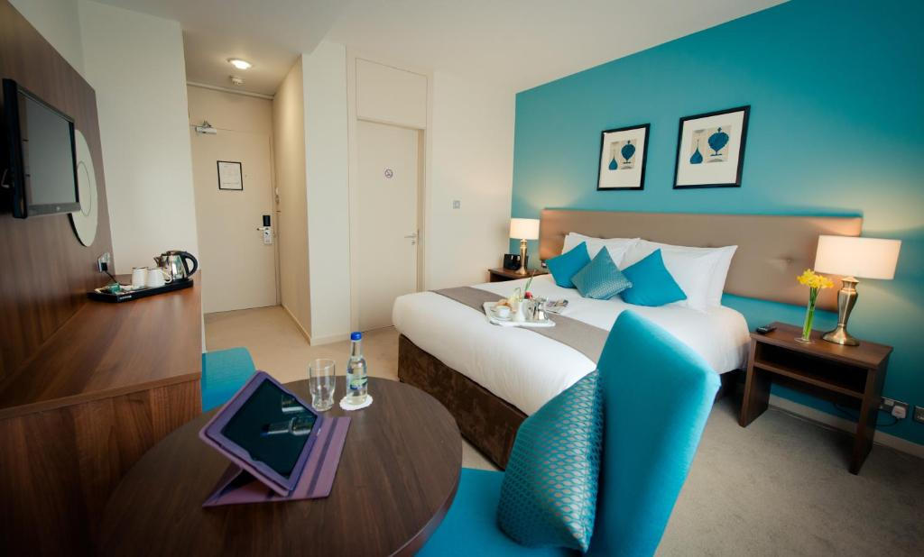A bed or beds in a room at IMI Residence Sandyford