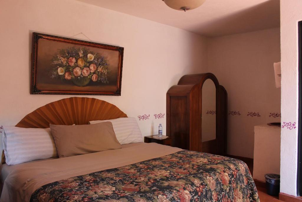 Cama o camas de una habitación en Hotel Posada Chamacuero