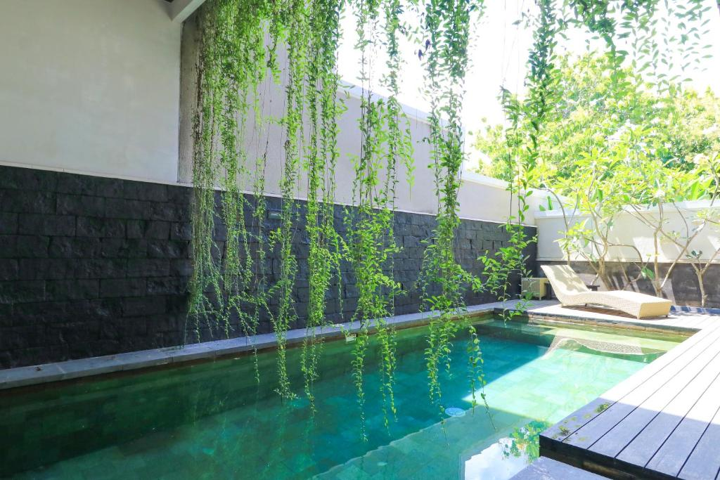The swimming pool at or near Kenzo Villas