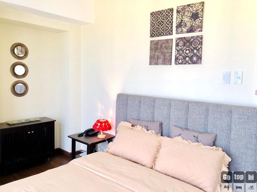 A bed or beds in a room at GOTOPHI @ The Knightsbridge Residences 1 BR 5124