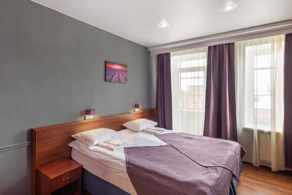 A bed or beds in a room at RA Hotel at Tambovskaya 11
