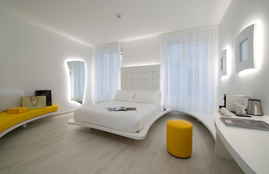 A bed or beds in a room at AHD Rooms