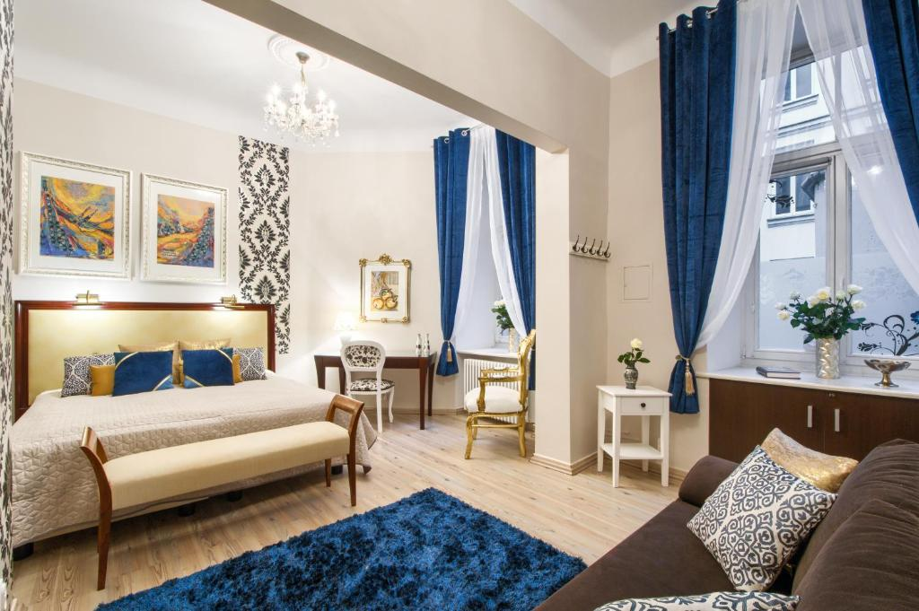 A bed or beds in a room at ClickTheFlat Palace Of Culture Art Apartment