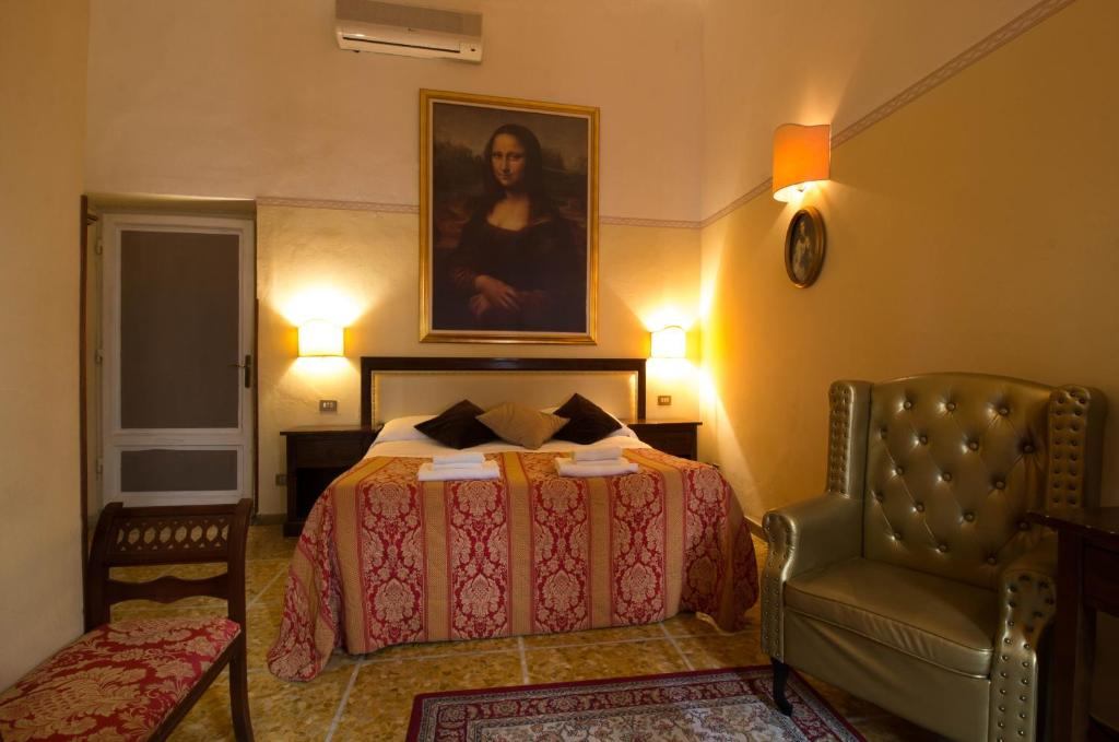A bed or beds in a room at Tourist House Duomo