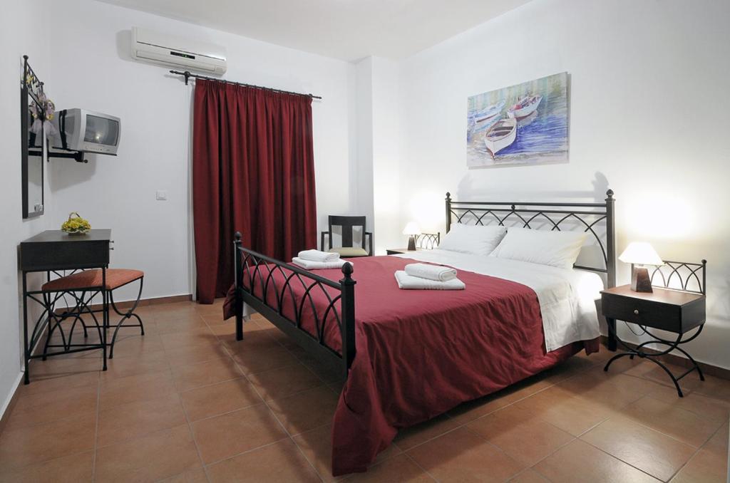 Ein Bett oder Betten in einem Zimmer der Unterkunft Kythera Golden Sun