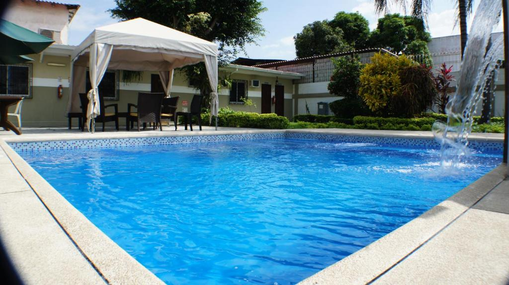 The swimming pool at or near Urdesa Suites Hotel