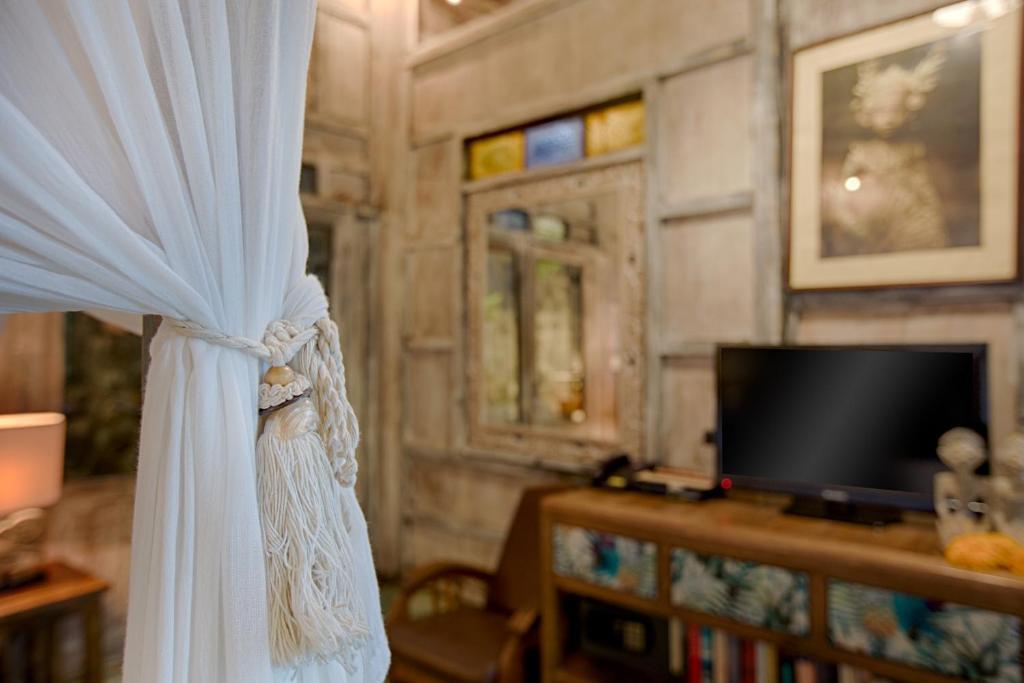Télévision ou salle de divertissement dans l'établissement Villa Awang Awang