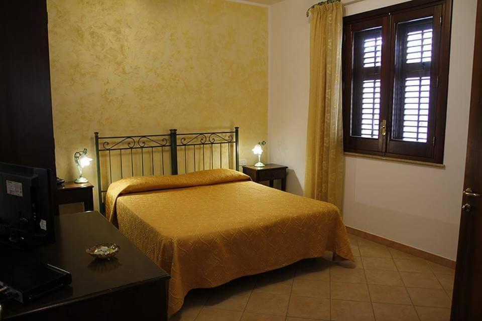 A bed or beds in a room at Abbadia
