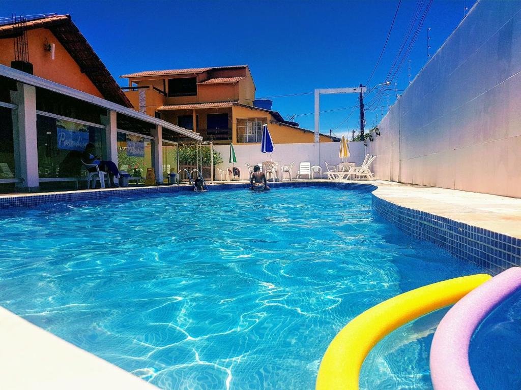 A piscina localizada em Pousada Paradise ou nos arredores