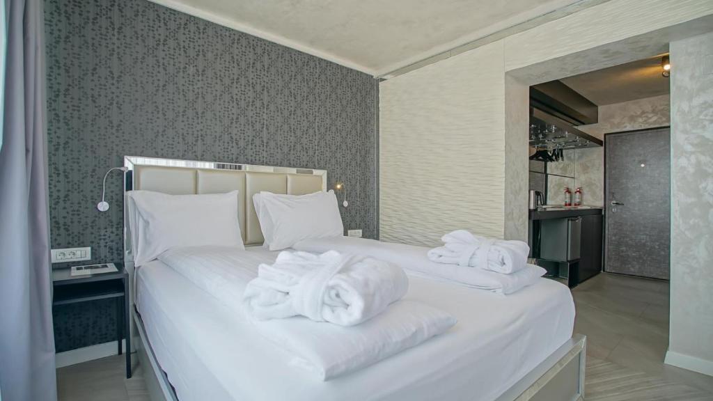 Lova arba lovos apgyvendinimo įstaigoje Z Executive Boutique Hotel