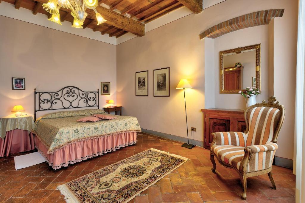 A bed or beds in a room at Antica Casa Naldi