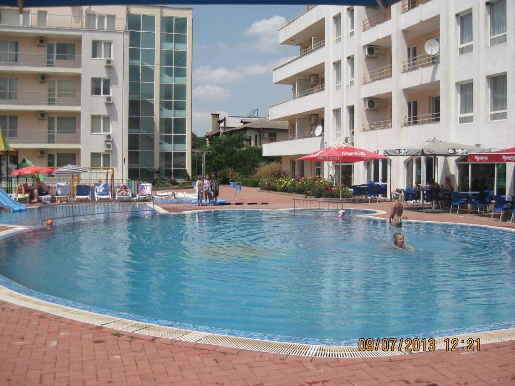 The swimming pool at or near Sarafovo Residence