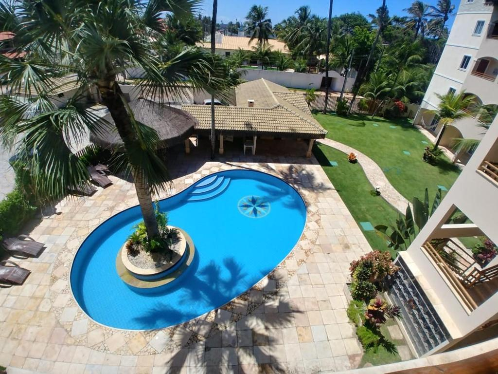 A view of the pool at Cumbuco Residence or nearby