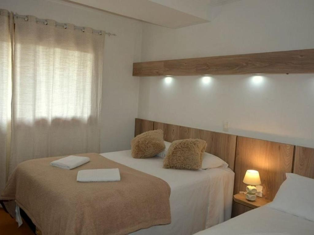 A bed or beds in a room at Mont Blanc Centro-A 600m Rua Coberta
