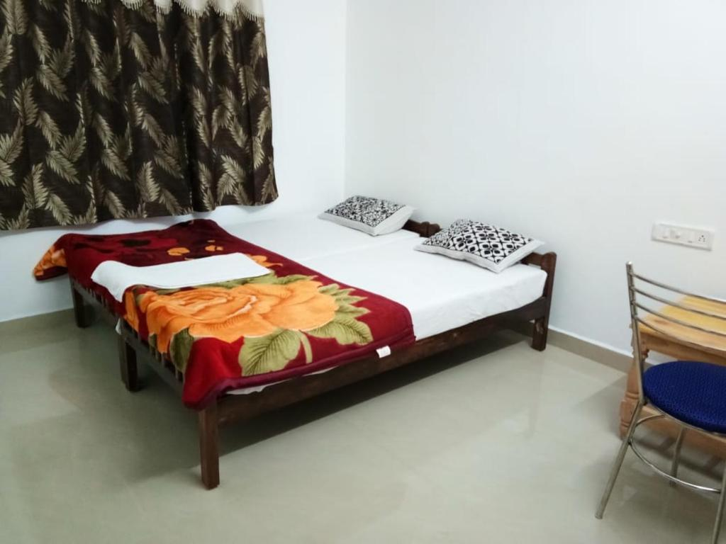 A bed or beds in a room at Spice Cottage Homestay