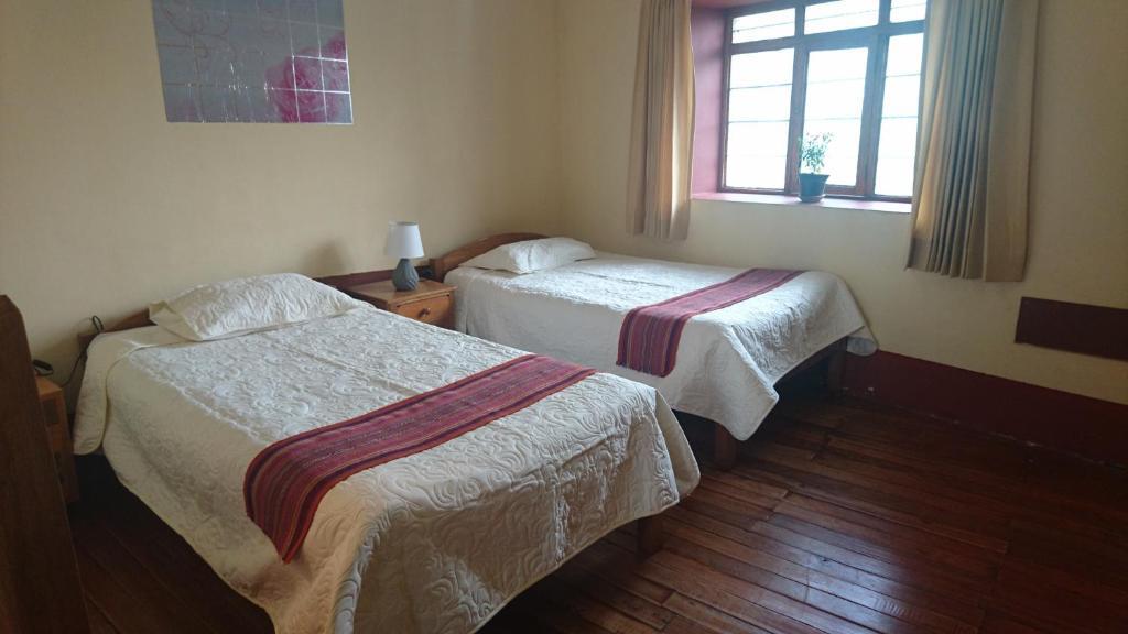 Cama o camas de una habitación en Sumaq Tikaq