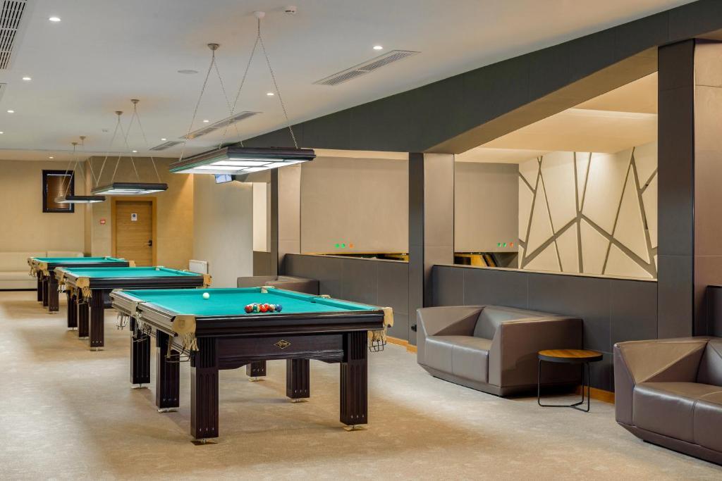 A pool table at LES Art Resort