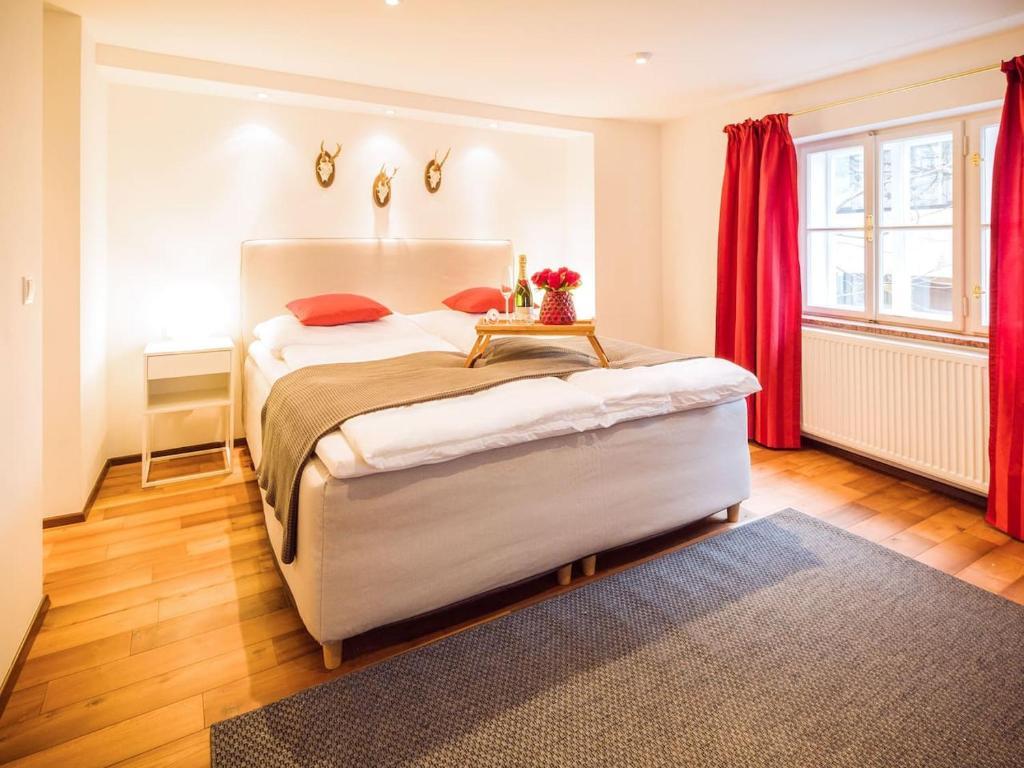 Ein Bett oder Betten in einem Zimmer der Unterkunft Exclusive Apartment Don Giovanni