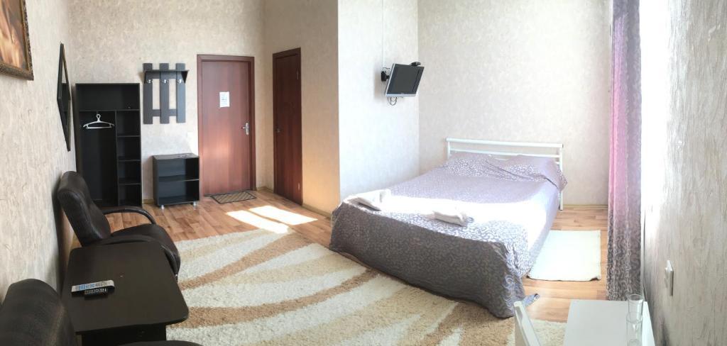 Кровать или кровати в номере Гостиница Придорожная