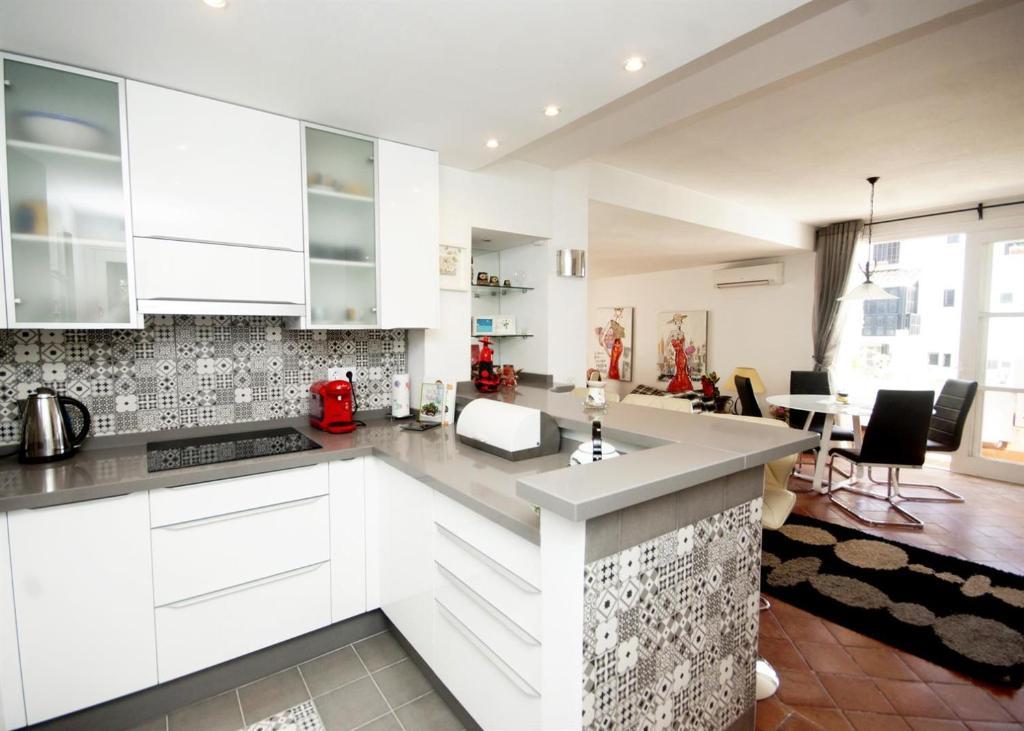 A kitchen or kitchenette at Los Jardines de Las Golondrinas