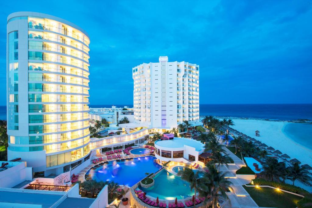 A view of the pool at Reflect Cancun Resort & Spa - All Inclusive or nearby