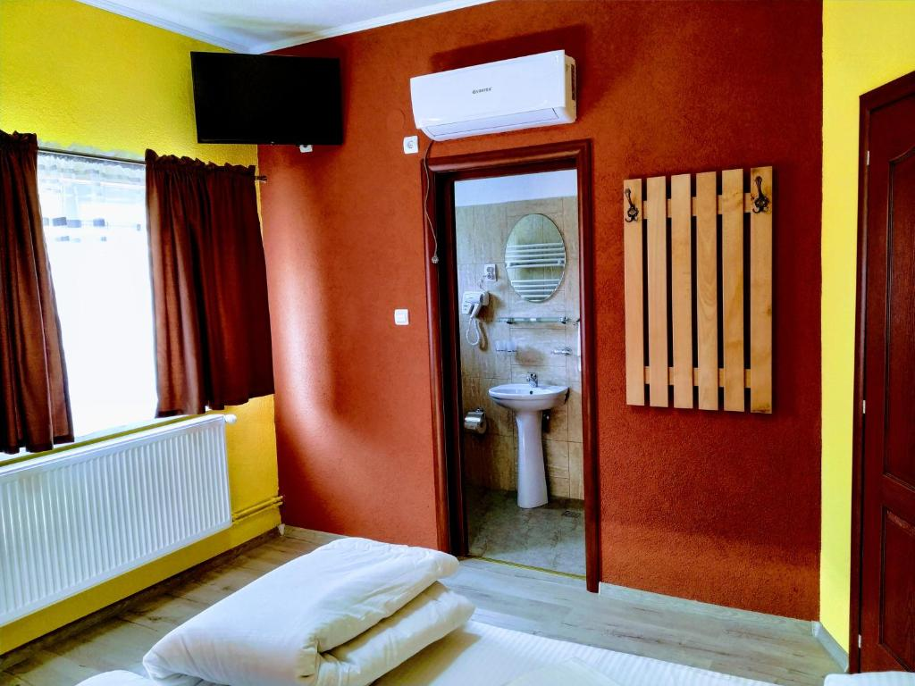 Un pat sau paturi într-o cameră la Venesis House