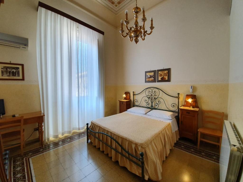 Letto o letti in una camera di Albergo Cavour