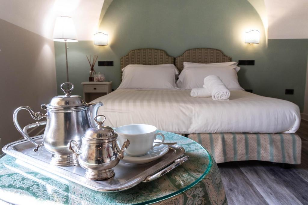 Gulta vai gultas numurā naktsmītnē Hotel Fontebella