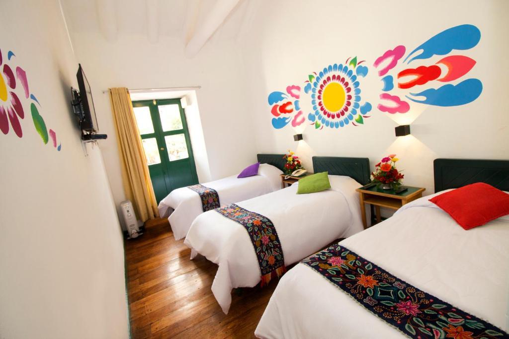 Cama o camas de una habitación en Cusco Plaza Nazarenas