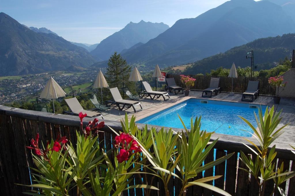 The swimming pool at or near Au Bon Logis