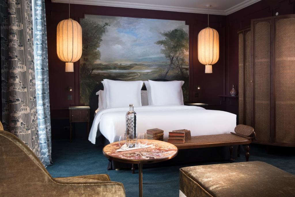 Un ou plusieurs lits dans un hébergement de l'établissement Hôtel Montecristo