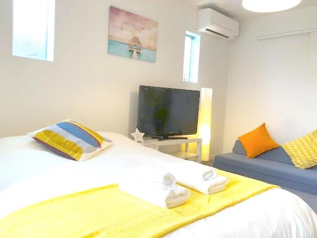 A bed or beds in a room at [NEW]Fukuoka best location room2/ 天神駅から電車で2分!!