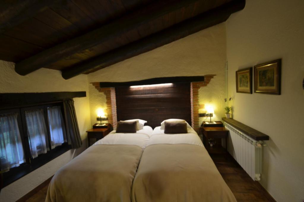 Cama o camas de una habitación en Comarquinal Bioresort Penedes