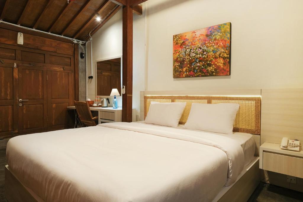 Tempat tidur dalam kamar di Kampung Lawasan Heritage Cottage