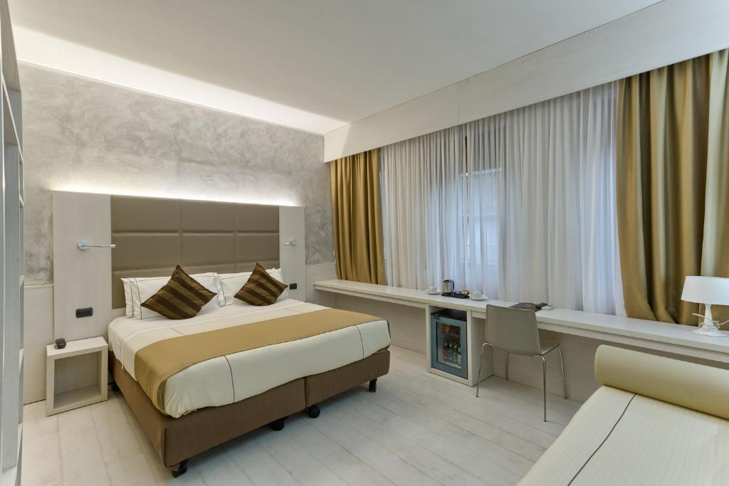 A bed or beds in a room at Agape Hotel