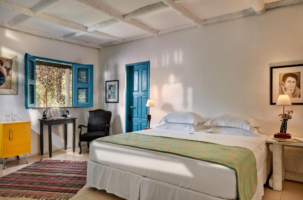 A bed or beds in a room at Alchymist Art Hotel - Jericoacoara