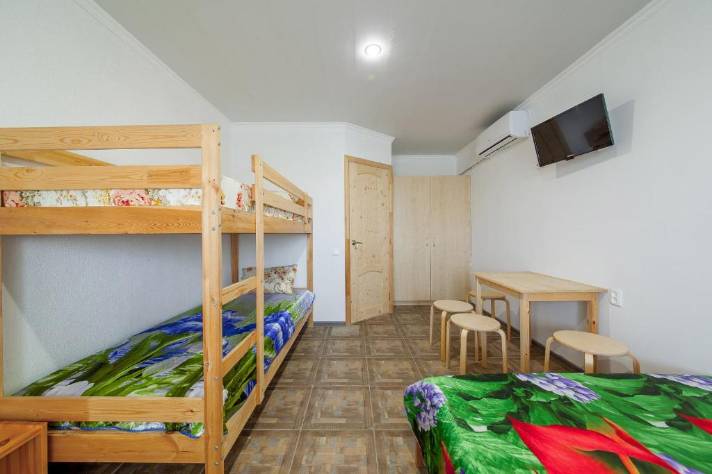 A bunk bed or bunk beds in a room at Guest House Aura