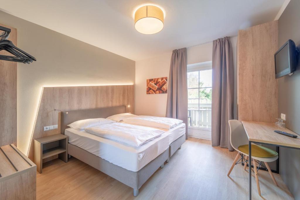 Ein Bett oder Betten in einem Zimmer der Unterkunft Garni Hotel Ritterhof