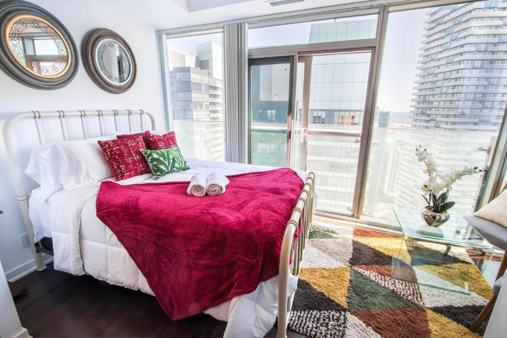 A bed or beds in a room at MiCasa Suites - Modern Executive Condo