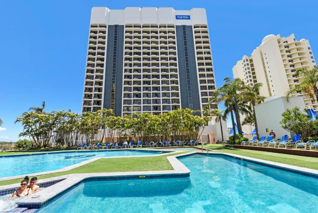 The swimming pool at or near Ocean View King Room - Surfers Paradise